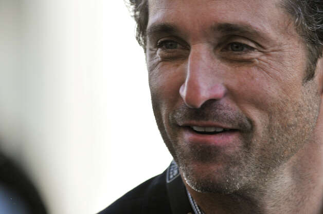 Actor Patrick Dempsey talks with friends Saturday at the Circuit of the America's in Austin. Photo:  Robin Jerstad/For The Express-News