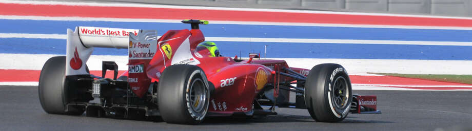 Felipe Massa in a Ferrari practices Saturday morning at the Circuit of the America's in Austin. Photo:  Robin Jerstad/For The Express-News
