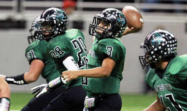 Dragon quarterback Lorenzo Gonzalez stays in the pocket and releases a pass as O'Connor plays Southwest in first round 5A playoff action at the Alamodome on November 17, 2012. Photo: Tom Reel, Express-News / ©2012 San Antono Express-News