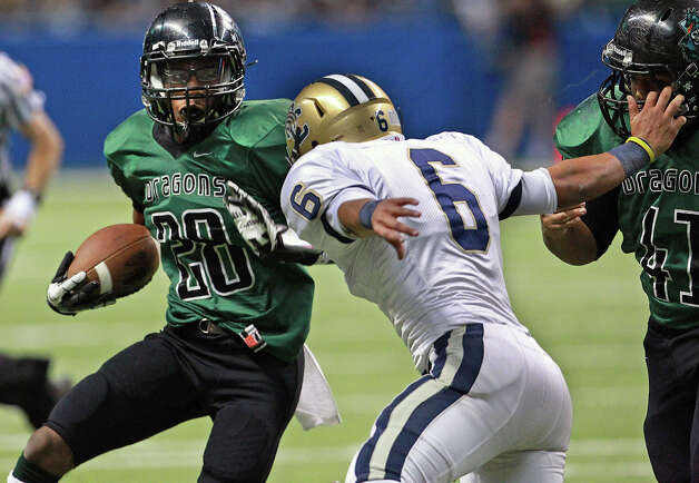 Dragon running back Erin Mack looks for room around Steven Cantu as O'Connor plays Southwest in first round 5A playoff action at the Alamodome on November 17, 2012. Photo: Tom Reel, Express-News / ©2012 San Antono Express-News