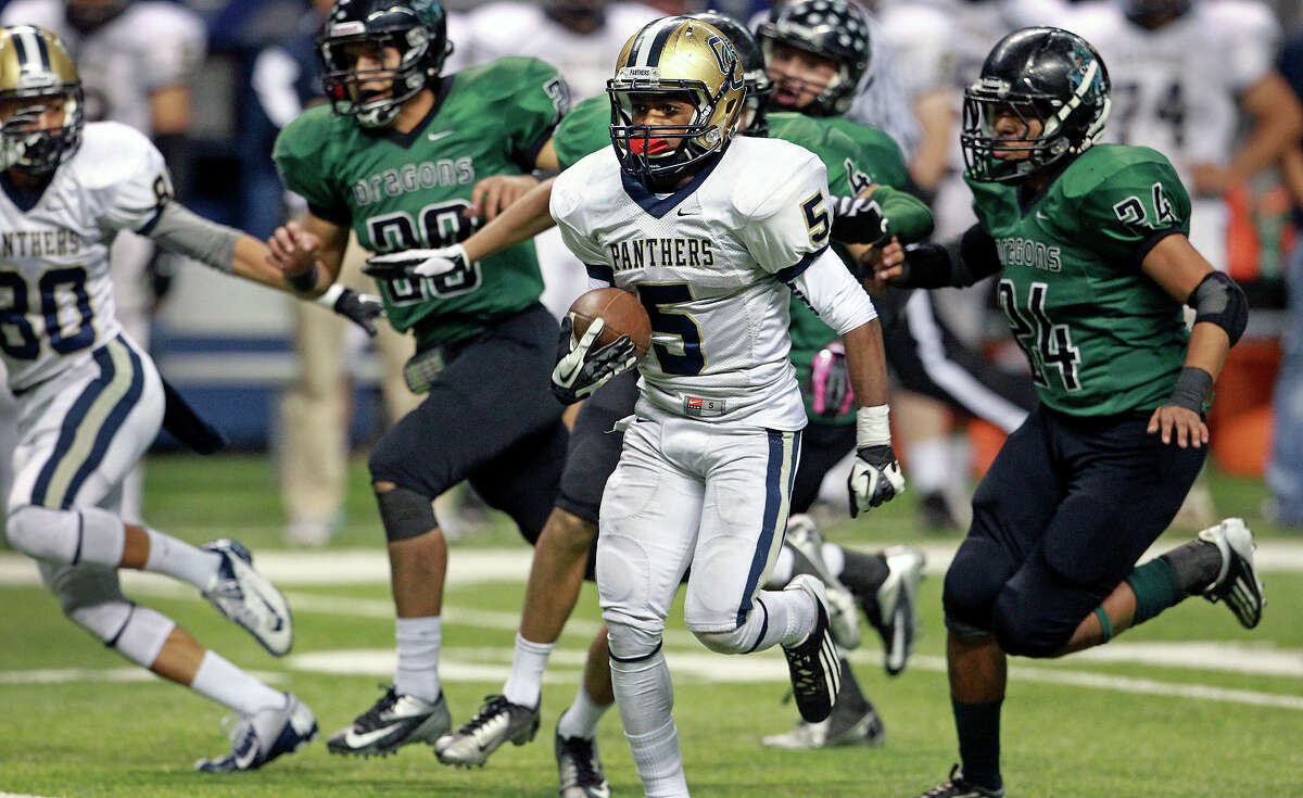 Tre Johnson rolls for a 63 yard touchdown in the third quarter for the Panthers as O'Connor plays Southwest in first round 5A playoff action at the Alamodome on November 17, 2012.