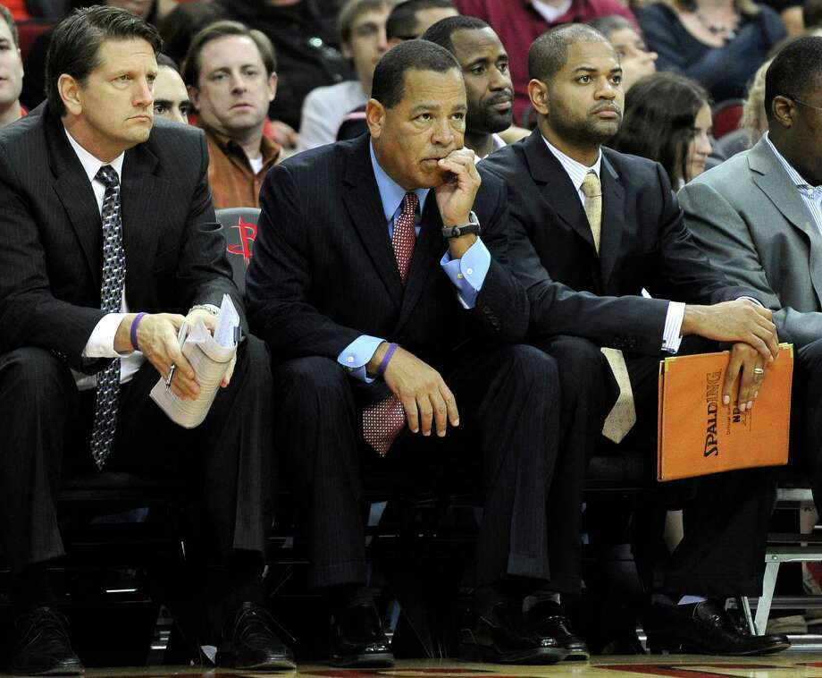 Rockets assistant coach Kelvin Sampson, center, is flanked by fellow assistants Chris Finch, left, and Bernie Bickerstaff Jr., both of whom have helped him follow in Kevin McHale's leadership style. Photo: Pat Sullivan, STF / AP