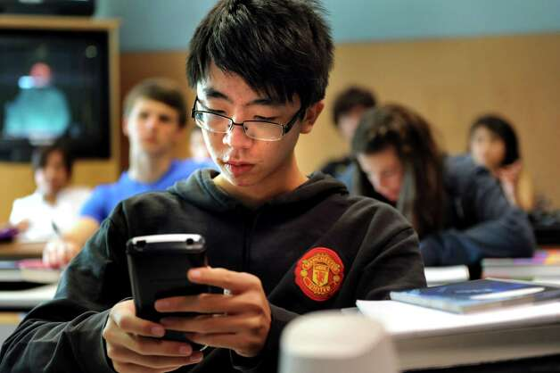 "Exchange student Xuan ""Sean"" Zhao, 17, of China works on a math problem in calculus class on Tuesday, Sept. 11, 2012, at Newcomb Central School in Newcomb, N.Y. (Cindy Schultz / Times Union) Photo: Cindy Schultz / 00019204A"