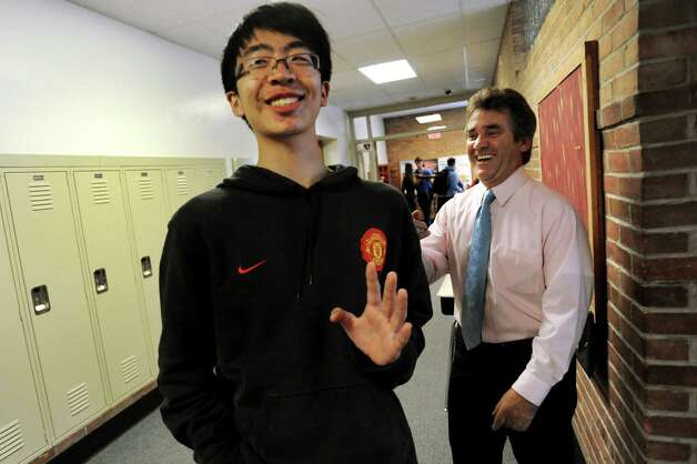 "Exchange student Xuan ""Sean"" Zhao, 17, of China, left, jokes with math teacher Ed LaCourse on Tuesday, Sept. 11, 2012, at Newcomb Central School in Newcomb, N.Y. (Cindy Schultz / Times Union) Photo: Cindy Schultz / 00019204A"