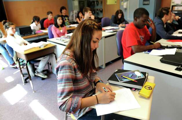 Exchange student Juliette Heyraud, 14, of France, center, works on a calculus problem on Tuesday, Sept. 11, 2012, at Newcomb Central School in Newcomb, N.Y. (Cindy Schultz / Times Union) Photo: Cindy Schultz
