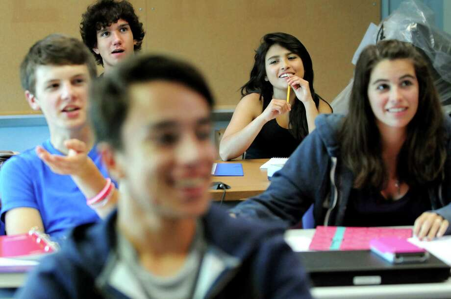 Exchange students Federico Portera, 17, of Italy, back left, and Camila Espana of Bolivia, back right, join native students in calculus class on Tuesday, Sept. 11, 2012, at Newcomb Central School in Newcomb, N.Y. (Cindy Schultz / Times Union) Photo: Cindy Schultz