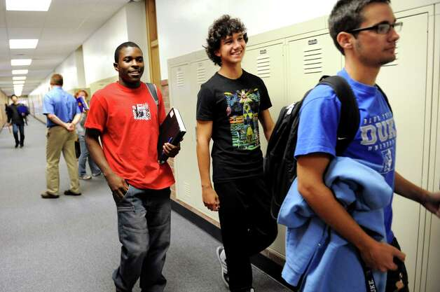 Exchange students Bryton Chikukwa, 18, of Zimbabwe, left, and Federico Portera, 17, of Italy, center, join Lukas Marra, 18, of Newcomb as they end the school day on Tuesday, Sept. 11, 2012, at Newcomb Central School in Newcomb, N.Y. (Cindy Schultz / Times Union) Photo: Cindy Schultz