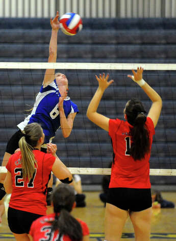 Darien's #6 Kelly Kosnik spikes the ball, during Class LL girls volleyball championship action against Cheshire in East Haven, Conn. on Saturday November 17, 2012. Photo: Christian Abraham / Connecticut Post