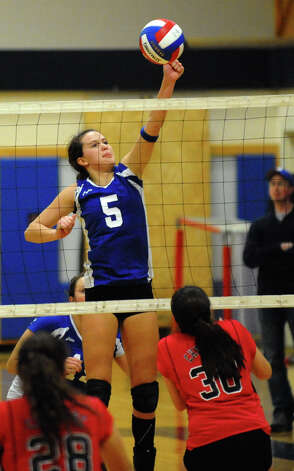 Darien's #5 Riley Sousa bumps the ball over to Cheshire, during Class LL girls volleyball championship action in East Haven, Conn. on Saturday November 17, 2012. Photo: Christian Abraham / Connecticut Post