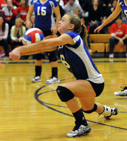 Darien's #6 Kelly Kosnik bumps the ball, during Class LL girls volleyball championship action against Cheshire in East Haven, Conn. on Saturday November 17, 2012. Photo: Christian Abraham / Connecticut Post