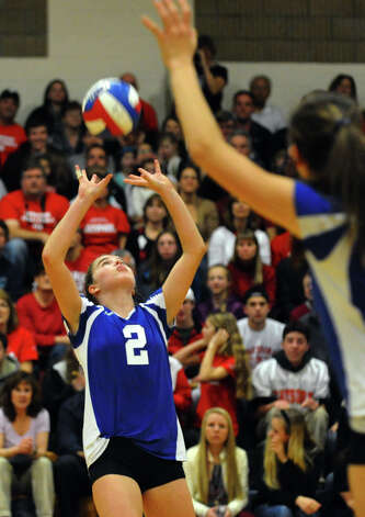 Darien's #2 Kathleen Burke sets the ball, during Class LL girls volleyball championship action against Cheshire in East Haven, Conn. on Saturday November 17, 2012. Photo: Christian Abraham / Connecticut Post