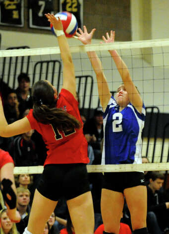 Darien's #2 Kathleen Burke goes to block a Cheshire shot, during Class LL girls volleyball championship action in East Haven, Conn. on Saturday November 17, 2012. Photo: Christian Abraham / Connecticut Post