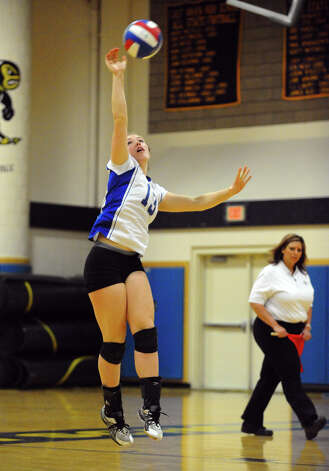 Darien's #13 Callan Clasby serves the ball, during Class LL girls volleyball championship action against Cheshire in East Haven, Conn. on Saturday November 17, 2012. Photo: Christian Abraham / Connecticut Post