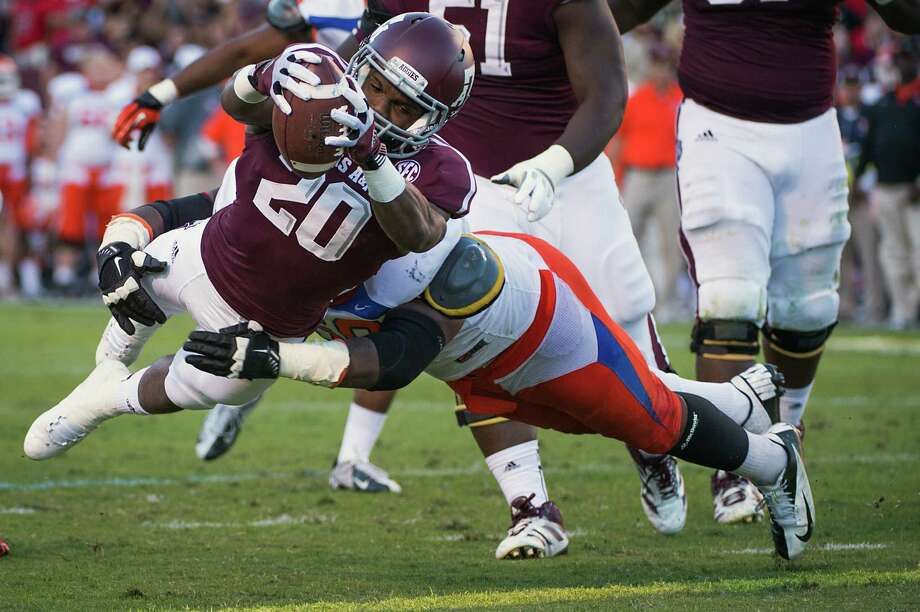 Trey Williams dives for a 6-yard touchdown in the second quarter that helped Texas A&M jump to a 34-0 halftime lead Saturday. Photo: Smiley N. Pool, Staff / © 2012  Houston Chronicle