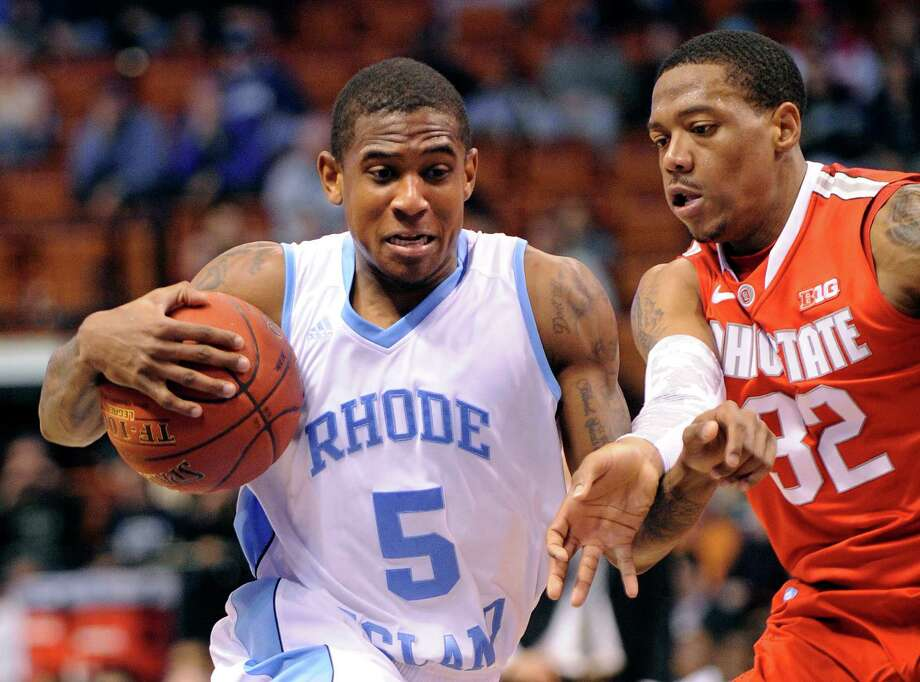 Rhode Island's Xavier Munford, left, drives past Ohio State's Lenzelle Smith, Jr. during the first half of an NCAA college basketball game, Saturday, Nov. 17, 2012, in Uncasville, Conn. Munford scored a team-high 16 in Rhode Island's 69-58 loss. (AP Photo/Fred Beckham) Photo: Fred Beckham