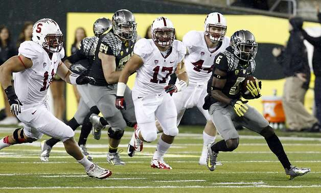 Oregon running back De'Anthony Thomas, right, breaks into the open field ahead of Stanford defenders, from left,Shayne Skov, A. J. Tarpley and Chase Thomas  during the first half of their NCAA college football game in Eugene, Ore., Saturday, Nov. 17, 2012.(AP Photo/Don Ryan) Photo: Don Ryan, Associated Press