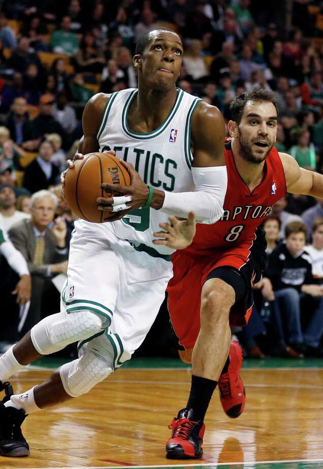 Boston Celtics' Rajon Rondo (9) drives past Toronto Raptors' Jose Calderon (8) in the first quarter of an NBA basketball game in Boston, Saturday, Nov. 17, 2012. (AP Photo/Michael Dwyer) Photo: Michael Dwyer