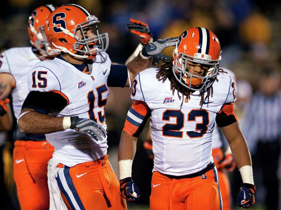 Syracuse's Prince-Tyson Gulley, right, is congratulated by teammate Alec Lemon, left, after Gulley scored on a 1-yard run during the second quarter of an NCAA college football game Saturday, Nov. 17, 2012, in Columbia, Mo. (AP Photo/L.G. Patterson) Photo: L.G. Patterson