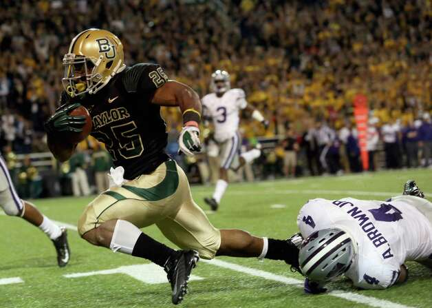 Lache Seastrunk #25 of the Baylor Bears runs the ball past Arthur Brown #4 of the Kansas State Wildcats at Floyd Casey Stadium on November 17, 2012 in Waco, Texas. Photo: Ronald Martinez, Getty Images / 2012 Getty Images