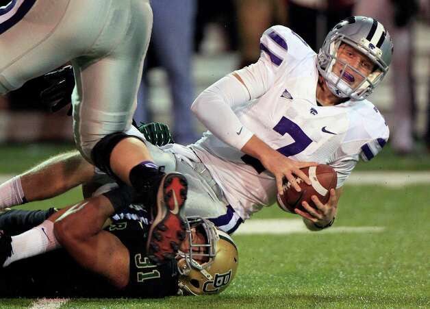 Kansas State quarterback Collin Klein was off this weekend. Kansas State fell out of the No. 1 spot after losing to Baylor a week ago.  (AP Photo/LM Otero) Photo: LM Otero, Associated Press / AP