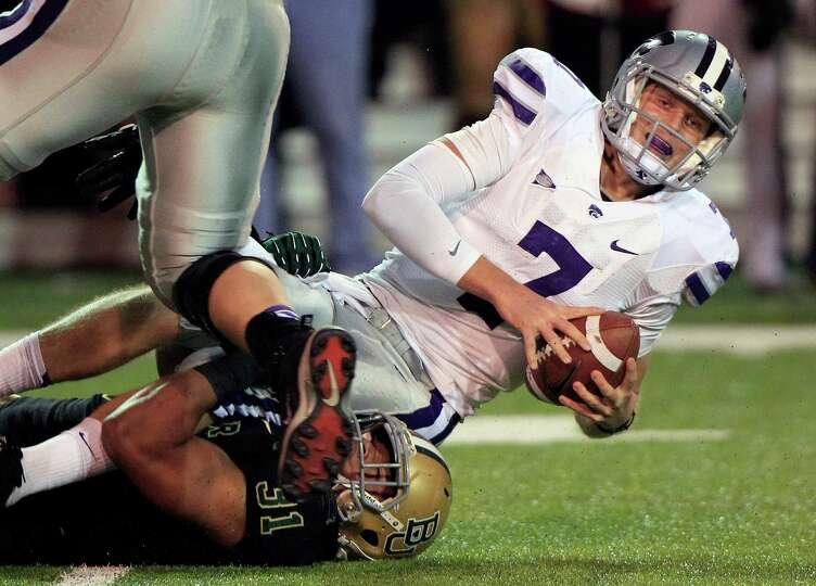 Kansas State quarterback Collin Klein (7) is sacked by Baylor defensive end Chris McAllister (31) du