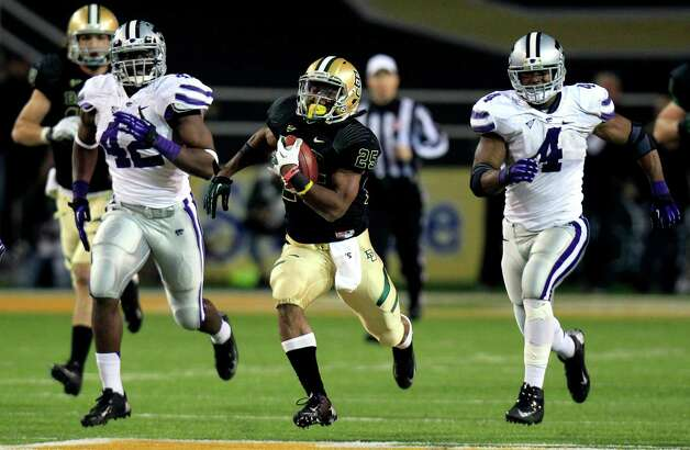 Baylor running back Lache Seastrunk (25) breaks away on a touchdown run against Kansas State defensive end Meshak Williams (42) and linebacker Arthur Brown (4) during the third quarter of an NCAA college football game, Saturday, Nov. 17, 2012, in Waco Texas.  (AP Photo/LM Otero) Photo: LM Otero, Associated Press / AP
