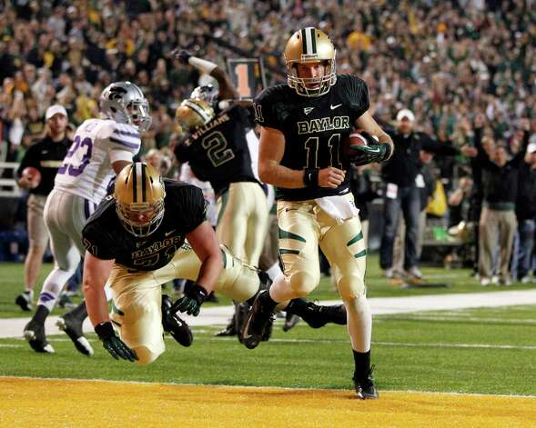 Baylor quarterback Nick Florence (11) runs in for a touchdown against Kansas State during the first half at Floyd Casey Stadium in Waco, Texas, on Saturday, November 17, 2012. (Vernon Bryant/Dallas Morning News/MCT) Photo: Vernon Bryant, McClatchy-Tribune News Service / Dallas Morning News
