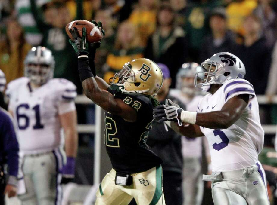 Baylor cornerback Joe Williams (22) intercepts a pass intended for Kansas State wide receiver Chris Harper (3) during the first half at Floyd Casey Stadium in Waco, Texas, on Saturday, November 17, 2012. (Vernon Bryant/Dallas Morning News/MCT) Photo: Vernon Bryant, McClatchy-Tribune News Service / Dallas Morning News