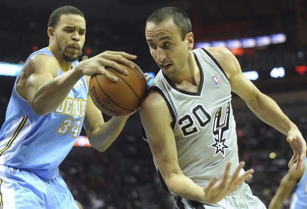 Manu Ginobili (20) of the San Antonio Spurs and JaVale McGee (34) of the Denver Nuggets battle for a loose ball during first-half NBA action in the Alamodome on Nov. 17, 2012. (Billy Calzada / San Antonio Express-News)