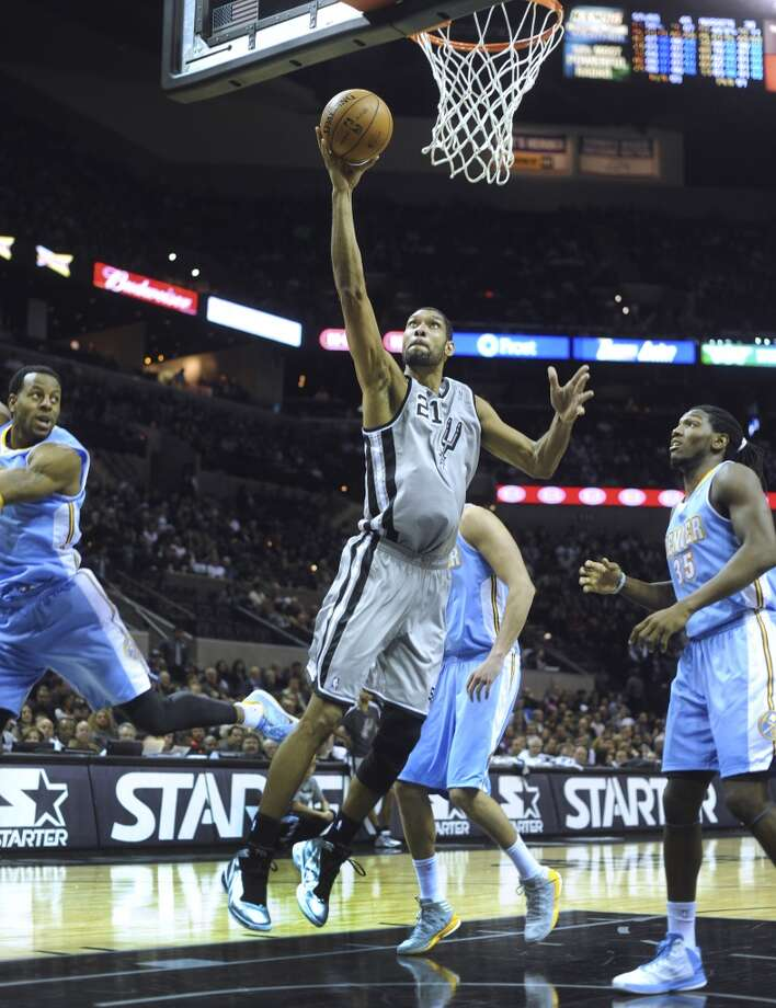 Tim Duncan of the San Antonio Spurs lays up the ball against Denver during NBA action in the Alamodome on Nov. 17, 2012. (Billy Calzada / San Antonio Express-News)