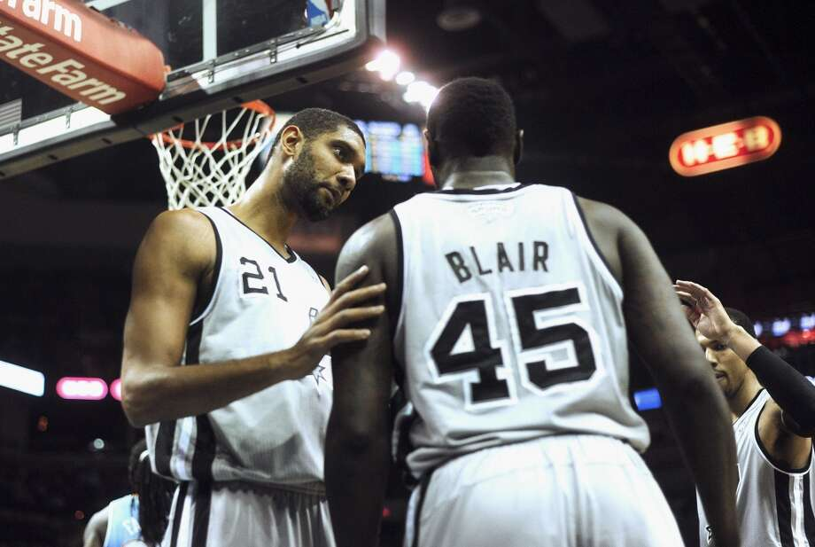 Spurs veteran forward Tim Duncan (21) converses with teammate DeJuan Blair during NBA action against Denver in the Alamodome on Nov. 17, 2012. (Billy Calzada / San Antonio Express-News)