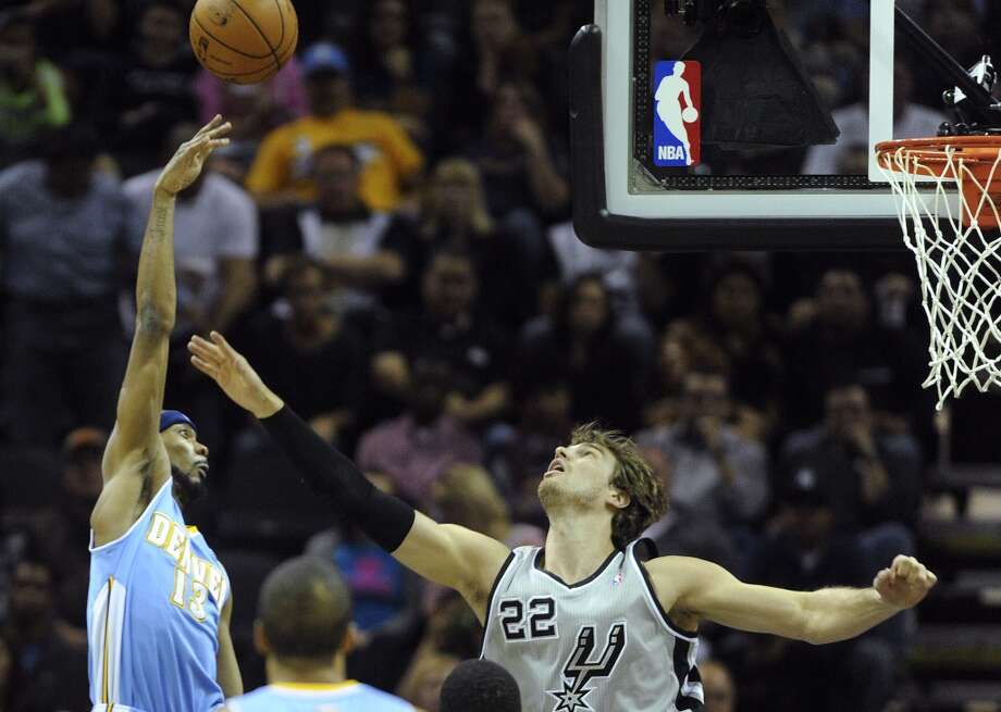 Corey Brewer of the Denver Nuggets shoots over Tiago  Splitter of the San Antonio Spurs during NBA action in the Alamodome on Nov. 17, 2012. (Billy Calzada / San Antonio Express-News)
