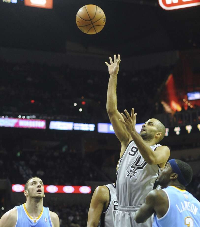 Tony Parker of the San Antonio Spurs shoots after an offensive rebound during NBA action against Denver in the Alamodome on Nov. 17, 2012. (Billy Calzada / San Antonio Express-News)