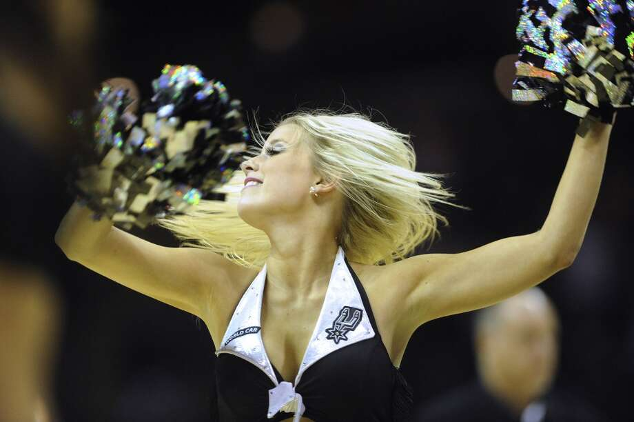 A Spurs Silver Dancer performs during a timeout as the Spurs take on the Denver Nuggets in NBA action in the Alamodome on Nov. 17, 2012. (Billy Calzada / San Antonio Express-News)