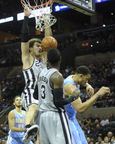 Tiago Splitter of the San Antonio Spurs dunks against the Denver Nuggets during fourth-quarter NBA action in the Alamodome on Nov. 17, 2012. (Billy Calzada / San Antonio Express-News)