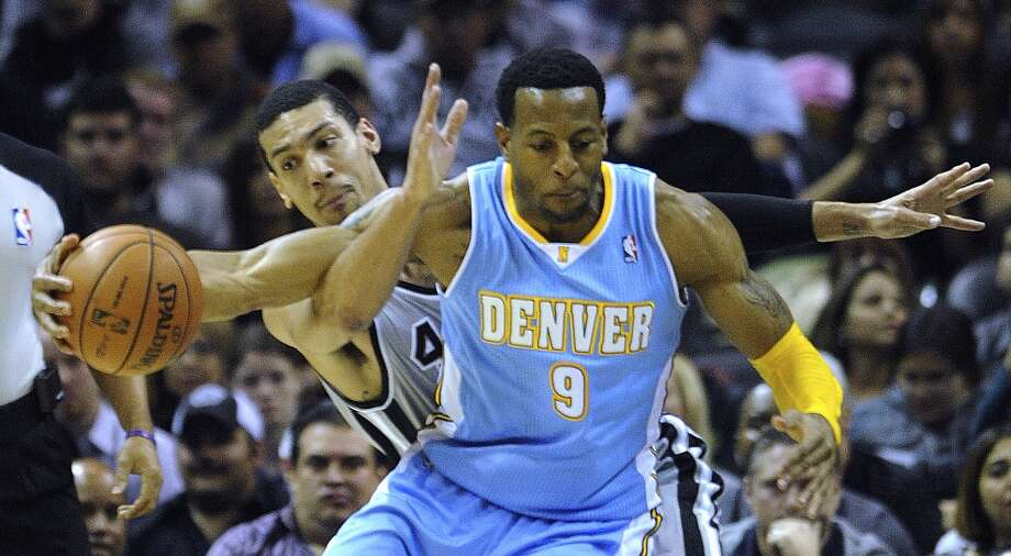 Danny Green of the San Antonio Spurs knocks the ball away from the Nuggets' Andre Iguodala during NBA action in the Alamodome on Nov. 17, 2012. The Spurs won, 126-100. (Billy Calzada / San Antonio Express-News)