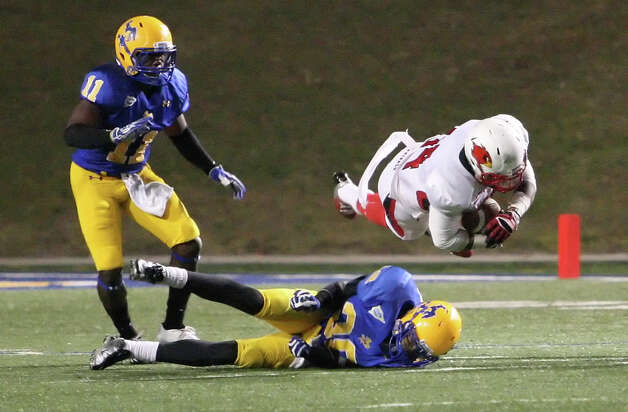 Lamar running back DePauldrick Garrett, right, is tackled by McNeese's Kenny Brown during the game Saturday at Cowboy Stadium in Lake Charles, La. (Matt Billiot/Special to the Enterprise)