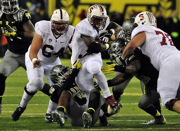 Stanford running back Stepfan Taylor carries linebacker Michael Clay (46, a senior out of San Jose's Bellarmine Prep) along with the ball in the first quarter. Photo: Steve Dykes, Getty Images