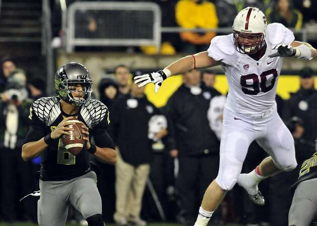 Defensive end Josh Mauro (90) and the Stanford defense vexed Marcus Mariota and the Ducks. Photo: Steve Dykes, Getty Images