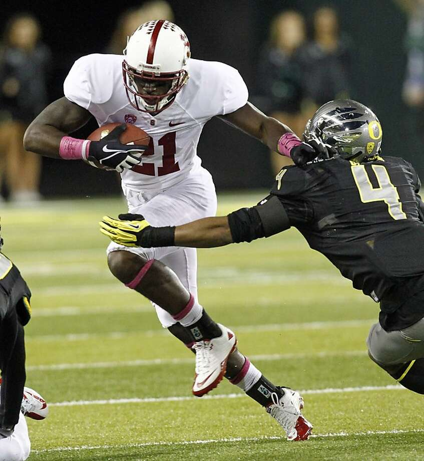 Stanford receiver Jamal-Rashad Patterson, left, tries to elude Oregon defender Erick Dargan during the first half of their NCAA college football game in Eugene, Ore., Saturday, Nov. 17, 2012.(AP Photo/Don Ryan) Photo: Don Ryan, Associated Press