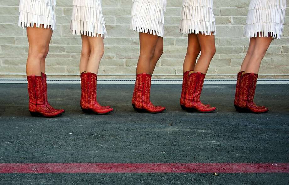 Cowgirls wait to march out to the track after the qualifying session for the U.S. Formula One Grand Prix at the Circuit of the Americas in Austin. Photo: Jim Watson, AFP/Getty Images