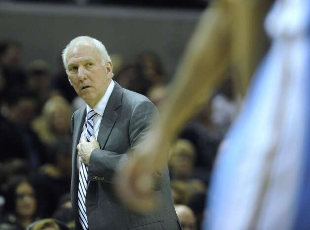 San Antonio Spurs Gregg Popovich watches his team in action against the Denver Nuggets in the Alamodome on Saturday, Nov. 17, 2012. The Spurs won, 126-100. (Billy Calzada / San Antonio Express-News)