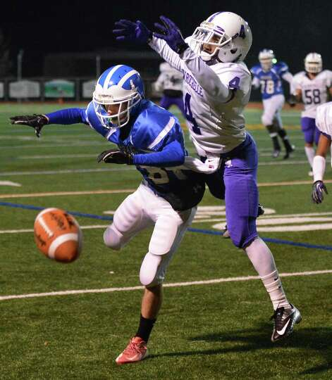 New Rochelle's #4 Wjhante Holden breaks up a pass to Shaker's # 24 Matt Woods during the Class AA st