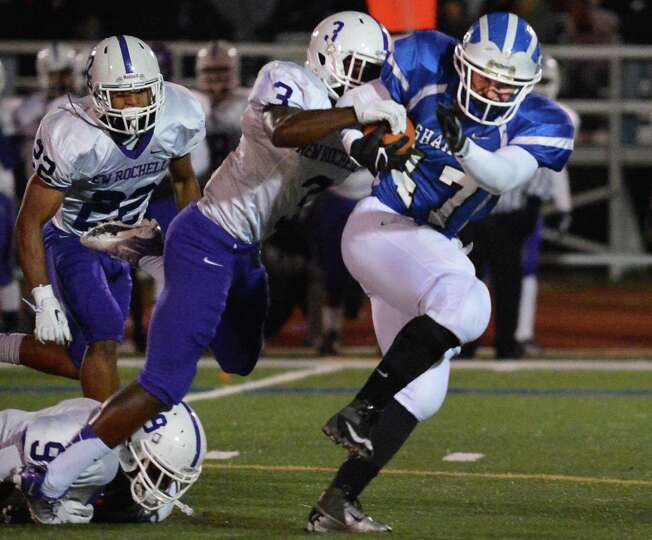 Shaker's #47 Ryan Griffin, at right, is brought down by New Rochelle's #3  Jason Ceneus during the C