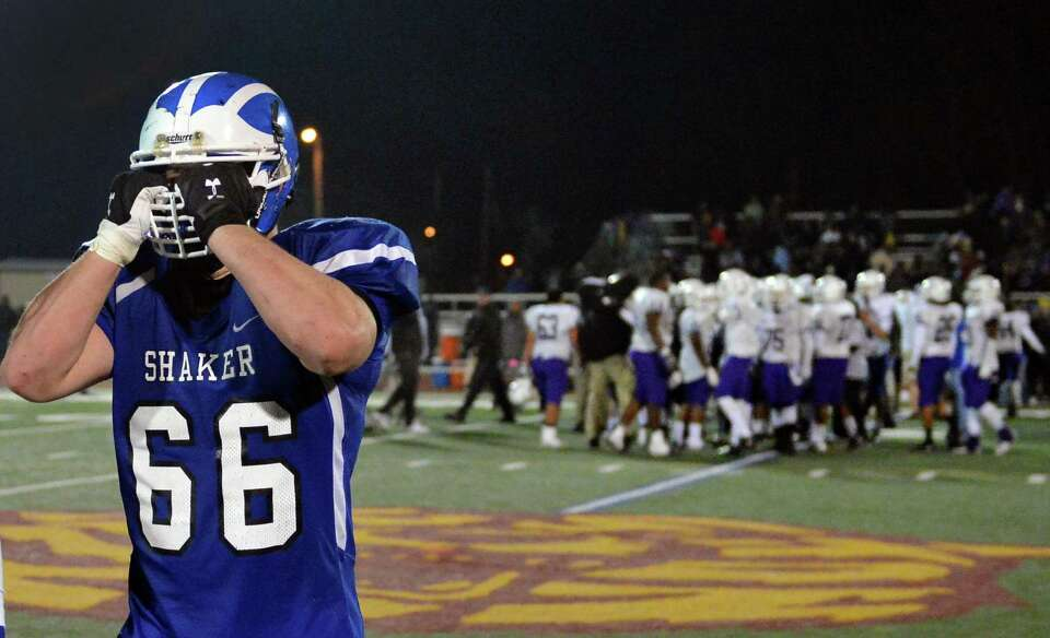 Shaker lineman #66 Schuyler Huntington reacts their last minute loss to New Rochelle in the Class AA