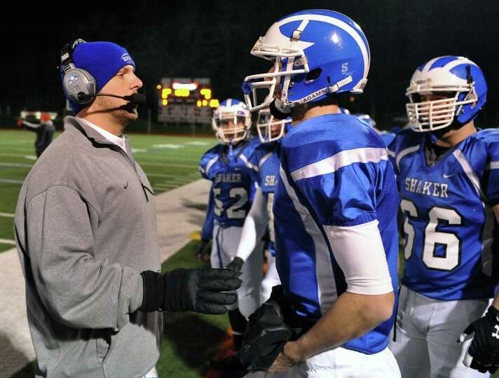 Shaker head coach Grag Sheeler with quarterback #5 Chris Landers on the sidelines during their Class