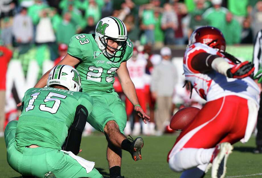 Marshall's Justin Haig kicks a field goal as teammate Blake Frohnapfel holds during an NCAA college football game against Houston on Saturday, Nov. 17, 2012, at Joan C. Edwards Stadium in Huntington, W.Va. Marshall won 44-41. (AP Photo/The Herald-Dispatch, Mark Webb) Photo: Mark Webb, Associated Press / Herald Dispatch