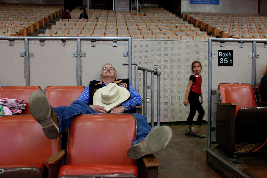Jerry Dominguez, of Castro Valley, naps between competitions at The Grand National Drill Team Jackpot. Photo: Mike Kepka, The Chronicle / ONLINE_YES