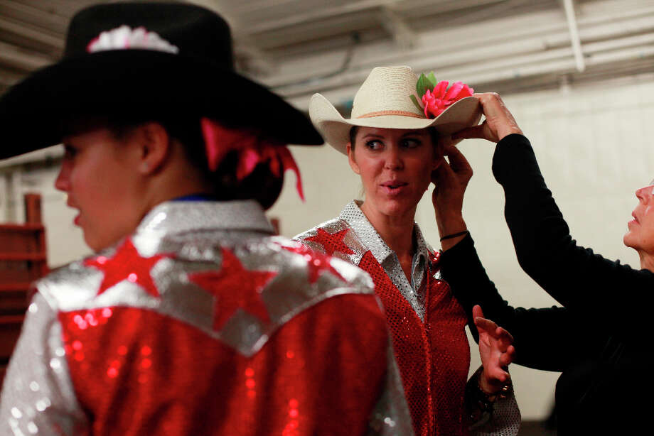 Rhonda Ebojo with the Smokin' Guns get the final touch on her look before competing at The Grand National Drill Team Jackpot. Photo: Mike Kepka, The Chronicle / ONLINE_YES