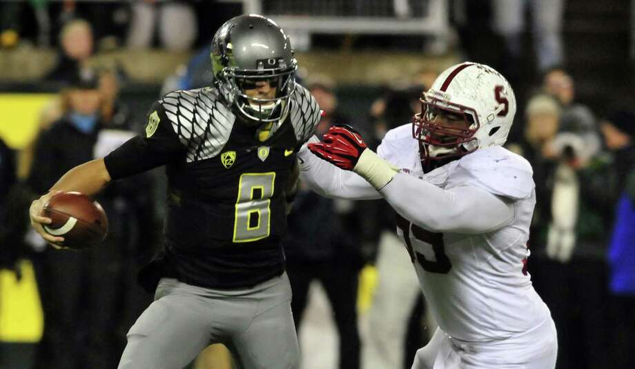 Stanford's Terrence Stephens puts the heat on Oregon quarterback Marcus Mariota. Photo: Steve Dykes, Stringer / 2012 Getty Images